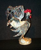 Rooster on a base woodcarving sculpture